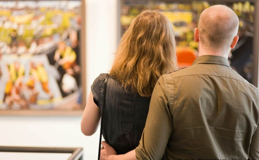 a couple looking at art at a Finger Lakes Museums