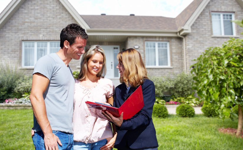 Couple speaking with realtor