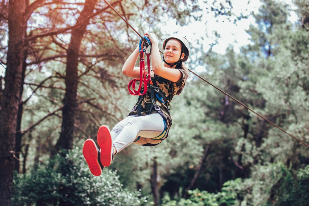 Girl on a zipline in an adventure park