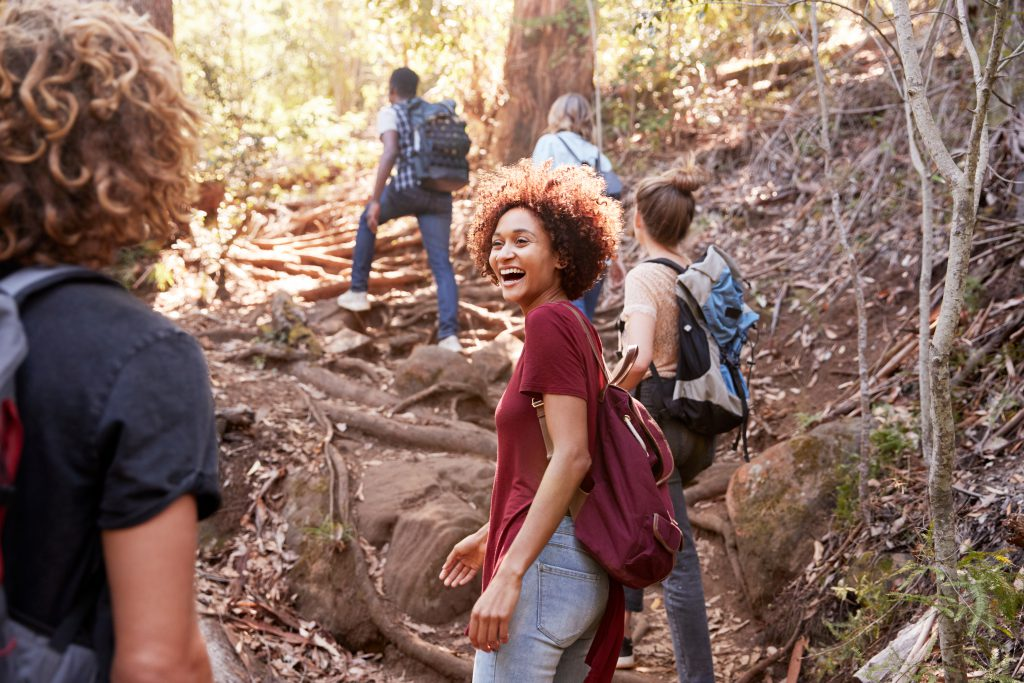 A group of friends hiking and smiling